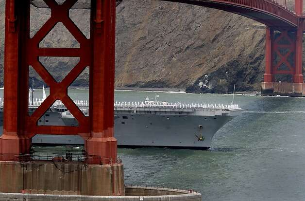 The aircraft carrier Nimitz entered the bay under the Golden Gate with all hands on deck. The Golden Gate Bridge celebrated its 75th anniversary with tours, displays, and music, ending with a fireworks display in San Francisco, Calif. Sunday May 27, 2012. Photo: Brant Ward, The Chronicle