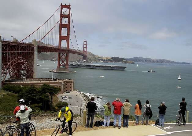 The aircraft carrier Nimitz sailed under the Golden Gate Bridge, all hands on deck. The Golden Gate Bridge celebrated its 75th anniversary with tours, displays, and music, ending with a fireworks display in San Francisco, Calif. Sunday May 27, 2012. Photo: Brant Ward, The Chronicle