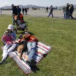 Katherine and Alex Katz have a large patch of grass to themselves and their daughter Paige and dog Pancho on the Marina Green at the 75th anniversary celebration for the Golden Gate Bridge in San Francisco, Calif. on Sunday, May 27, 2012.