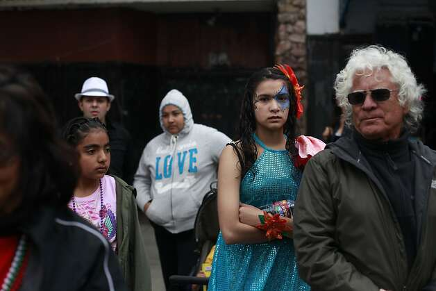 After performing with the Mission Cultural Center, Perla Caro, 14, watch the more of the parade during the 34th annual Carnaval parade on Sunday May 27, 2012 in San Francisco, Calif. Photo: Mike Kepka, The Chronicle
