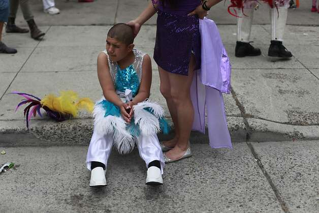 After dancing with Aquarela, Manuel Perez, 12, and his sister Brittney Vila rest at the end of the 34th annual Carnaval parade on Sunday May 27, 2012 in San Francisco, Calif. Photo: Mike Kepka, The Chronicle