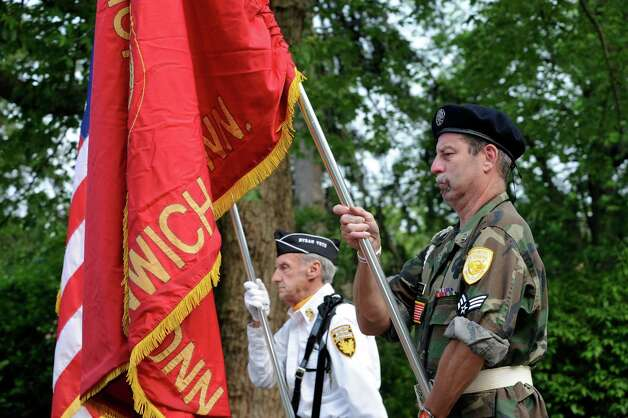 Byram Veteran Dennis Hughes, left, holds the American flag and veteran John Gawans hold the Ninth District Veterans flag during the Association's Memorial Day Parade in Glenville Sunday, May 27, 2012. Photo: Helen Neafsey / Greenwich Time