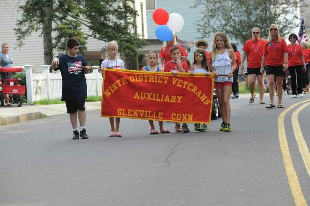 Holding the banner of Ninth District veterans auxiliary from left: Jack Caruso, 10, Kasey Kralik, 10, Ava Sollenne, 7, Patrick Caruso, 7, Charliegn Herbster, 6, and Sophie Merz, 10 during the Ninth District Veterans Association's Memorial Day Parade in Glenville Sunday, May 27, 2012. Photo: Helen Neafsey / Greenwich Time