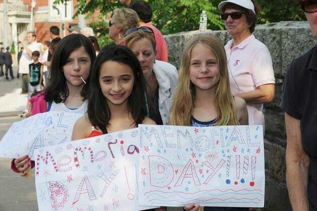 From left: Joanne Tedeso, 9, Jenna Marinaccio, 10, and Claire Napolitano, 9, made posters for the Ninth District Veterans Association's Memorial Day Parade in Glenville Sunday, May 27, 2012. Photo: Helen Neafsey / Greenwich Time