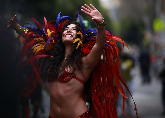 Dressed in feathers, Tala Khanmalek make her way down 24th street during the 34th annual Carnaval parade on Sunday May 27, 2012 in San Francisco, Calif. Photo: Mike Kepka, The Chronicle