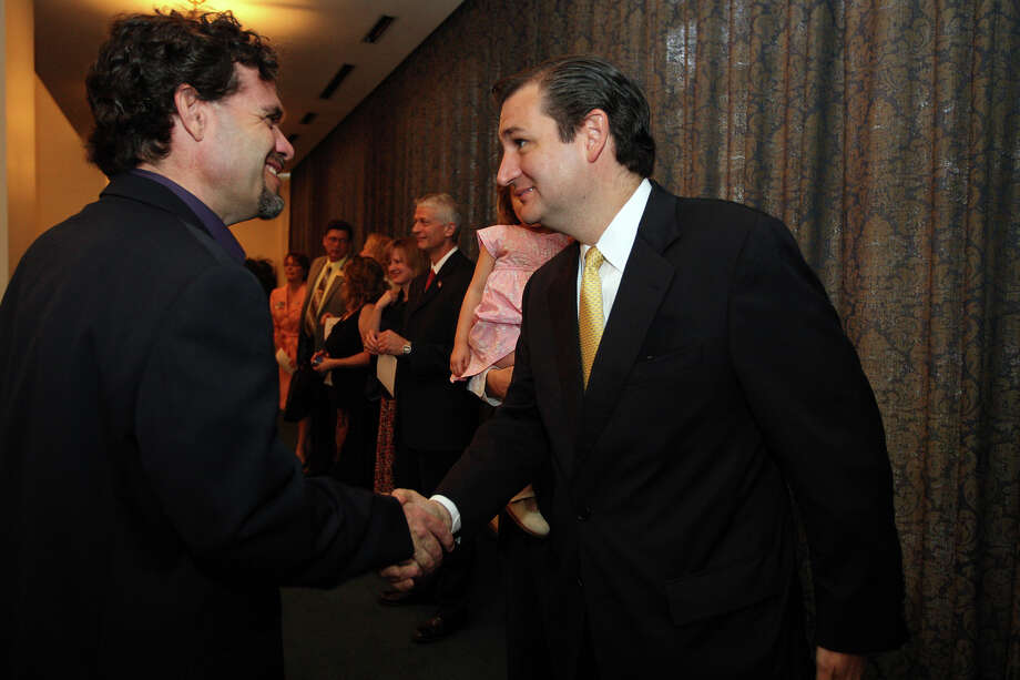 U.S. Senate candidate Ted Cruz, right, meets Kenneth Flippin before a service Sunday at Cornerstone Church in San Antonio. Photo: Jerry Lara / © 2012 San Antonio Express-News