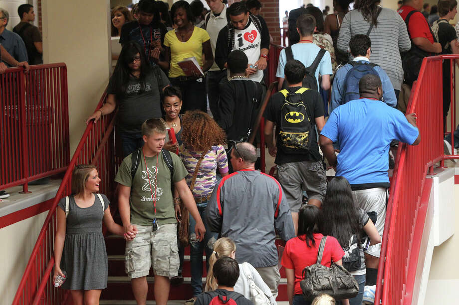 Students make their way down a crowded stairwell at Judson High School on Wednesday, May 23, 2012, during the lunch hour. The school enrolls about 400 more students than its 3,100 student capacity and is expected to have an enrollment of 4,153 by the fall of 2014. Photo: John Davenport, San Antonio Express-News