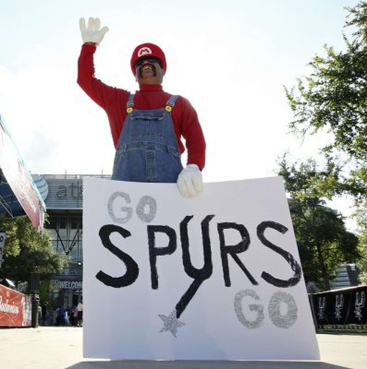Martin Galdiano waves to other fans before the first game of the NBA Western Conference Finals in San Antonio, Texas, Sunday, May 27, 2012. (San Antonio Express-News)