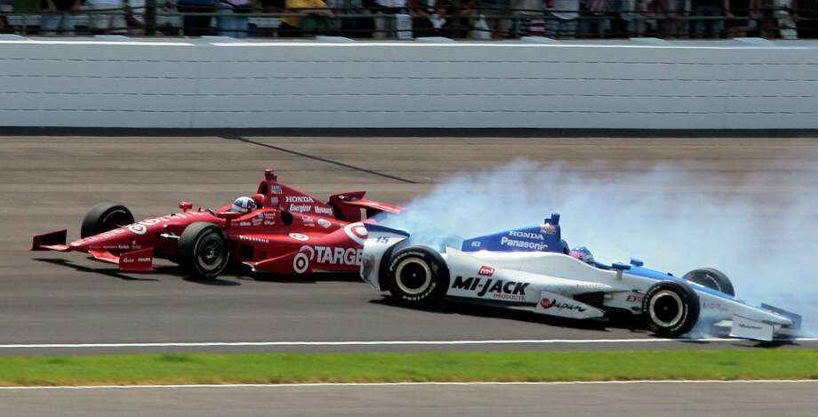Takuma Sato, right, spins out in the first turn as Dario Franchitti races past on the final lap of what would be Franchitti's third Indy 500 win. Photo: Bill Friel / AP