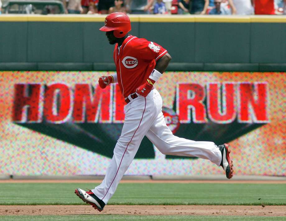 Brandon Phillips makes one of nine trots around the bases as the Rockies and Reds combined to set a record for home runs at Great American Ball Park. Photo: DAVID KOHL / FR51830 AP