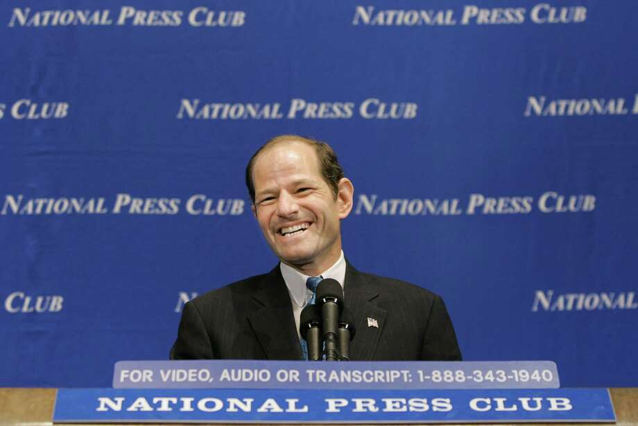 New York Attorney General Eliot Spitzer speaks at a sold-out luncheon at the National Press Club in Washington, Monday, Jan. 31, 2005. Earlier Monday, the nation's largest insurance brokerage, Marsh & McLennan Companies Inc., agreed to pay $850 million in restitution to end Spitzer's investigation into bid rigging and price fixing.  (AP Photo/J. Scott Applewhite) Photo: J. SCOTT APPLEWHITE / AP