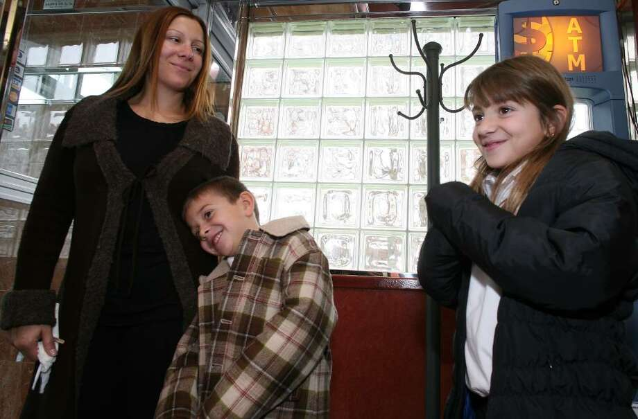 Maria Manessis,who was having lunch with her children Nicholas and Katerina at Glory Days Diner, felt the economy was doing well due to the number of people visiting restaurants. Photo: David Ames / Greenwich Time