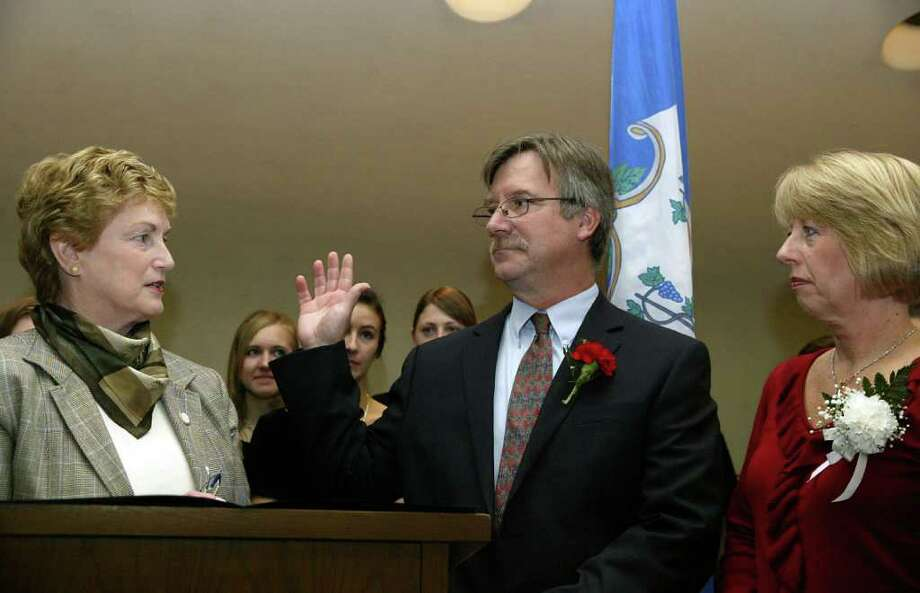 Governor M. Jodi Rell swears in Steve Vavrek, joined by wife Terri, as Monroe First Selectman during a brief ceremony at Monroe Town Hall, Monday, Nov. 23, 2009. Photo: Phil Noel / Connecticut Post