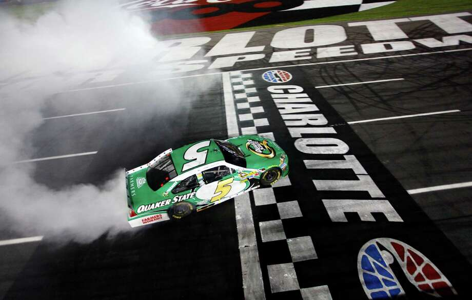 Kasey Kahne celebrates with a burnout after winning the Coca-Cola 600 for the third time on Sunday. Photo: Brian Lawdermilk / Pool HHP