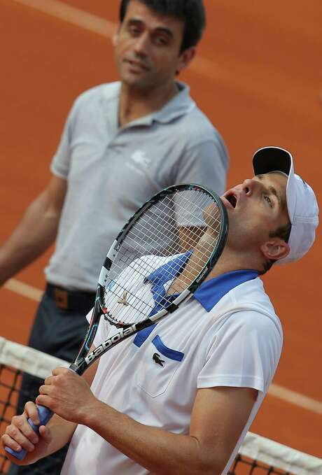 It was a frustrating day for American Andy Roddick, who lost to Nicolas Mahut, exiting in a major tournament's opening round for the first time since 2007. Photo: David Vincent / AP