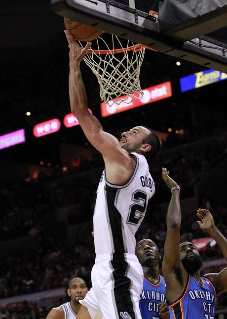 Spurs guard Manu Ginobili got to the basket often in the second half on the way to a season playoff-high 26 points in San Antonio's Game 1 win Sunday night. Photo: Ronald Martinez / 2012 Getty Images