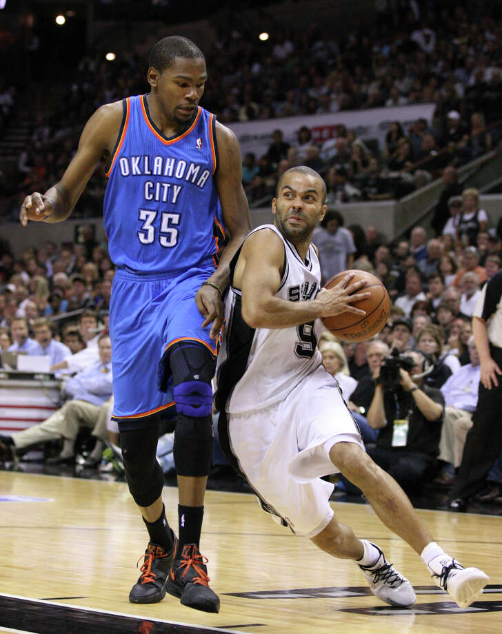 San Antonio Spurs' Tony Parker (9) drives against Oklahoma City Thunder's Kevin Durant (35) during the first half of game one of the NBA Western Conference Finals in San Antonio, Texas, Sunday, May 27, 2012. Photo: Edward A. Ornelas, Express-News / © 2012 San Antonio Express-News