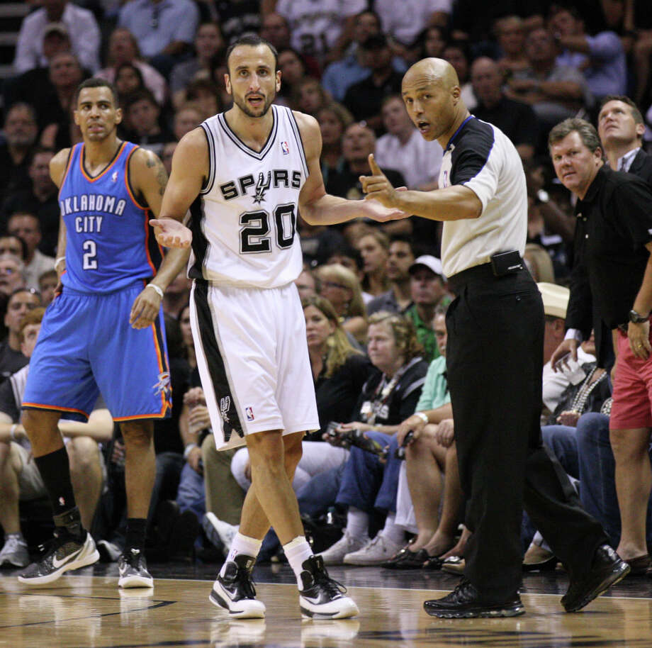 San Antonio Spurs' Manu Ginobili (20) reacts near an official during the first half of game one of the NBA Western Conference Finals in San Antonio, Texas, Sunday, May 27, 2012. Photo: Edward A. Ornelas, Express-News / © 2012 San Antonio Express-News