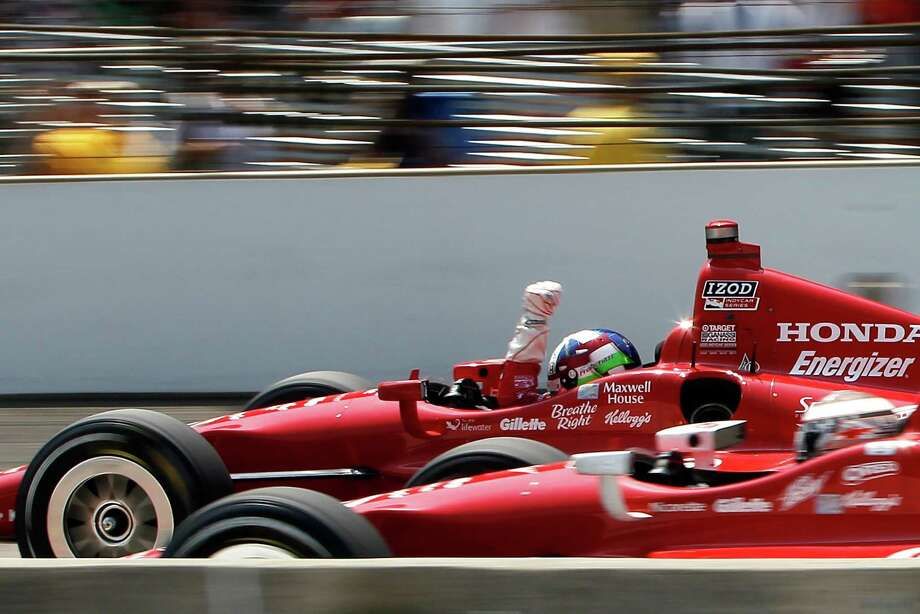 INDIANAPOLIS, IN - MAY 27:  Dario Franchitti of Scotland, driver of the #50 Target Chip Ganassi Racing Honda holds up his fist in celebration of wining the IZOD IndyCar Series 96th running of the Indianpolis 500 mile race at the Indianapolis Motor Speedway on May 27, 2012 in Indianapolis, Indiana.  (Photo by Jonathan Ferrey/Getty Images) Photo: Jonathan Ferrey / 2012 Getty Images