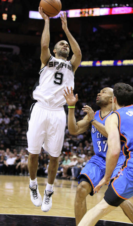 San Antonio Spurs' Tony Parker (9) shoots against Oklahoma City Thunder's Derek Fisher (37) and Oklahoma City Thunder's Nick Collison (4) during the first half of game one of the NBA Western Conference Finals in San Antonio, Texas, Sunday, May 27, 2012. Photo: Edward A. Ornelas, Express-News / © 2012 San Antonio Express-News