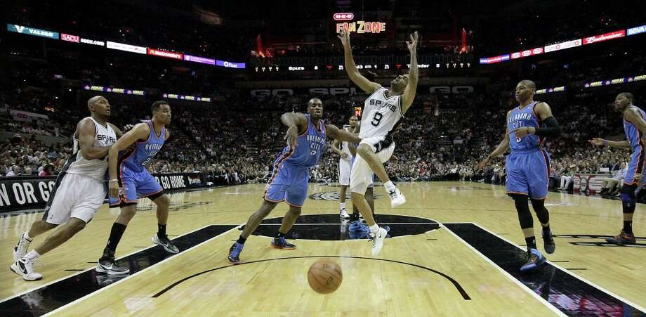 San Antonio Spurs' Tony Parker (9) loses control of the ball during the first half of game one of the NBA Western Conference Finals in San Antonio, Texas on Sunday, May 27, 2012. Photo: Kin Man Hui, Express-News / © 2012 San Antonio Express-News