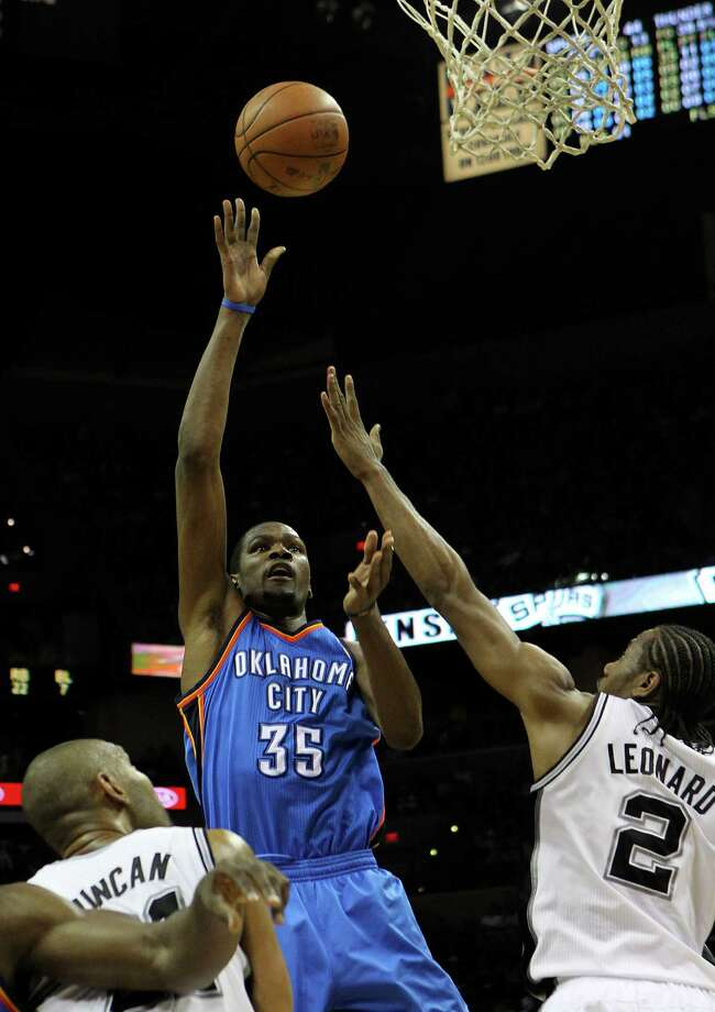 Oklahoma City Thunder's Kevin Durant (35) shoots over San Antonio Spurs' Kawhi Leonard (2) and San Antonio Spurs' Tim Duncan (21) during the first half of game one of the NBA Western Conference Finals in San Antonio, Texas on Sunday, May 27, 2012. Photo: Kin Man Hui, Express-News / © 2012 San Antonio Express-News