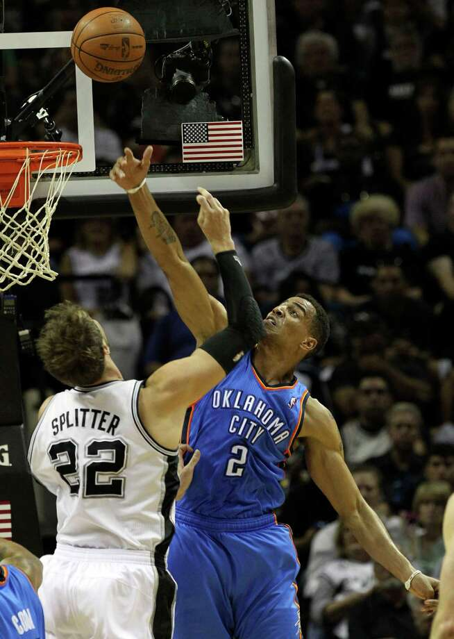 Oklahoma City Thunder's Thabo Sefolosha (2) blocks a shot by San Antonio Spurs' Tiago Splitter (22) during the first half of game one of the NBA Western Conference Finals in San Antonio, Texas on Sunday, May 27, 2012. Photo: Kin Man Hui, Express-News / © 2012 San Antonio Express-News