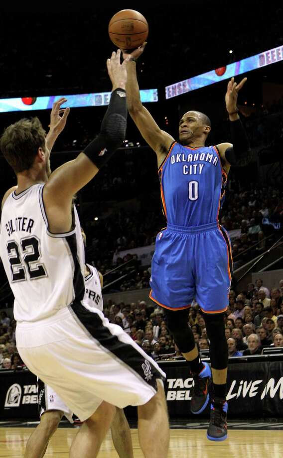 Oklahoma City Thunder's Russell Westbrook (0) shoots over San Antonio Spurs' Tiago Splitter (22) during the first half of game one of the NBA Western Conference Finals in San Antonio, Texas on Sunday, May 27, 2012. Photo: Kin Man Hui, Express-News / © 2012 San Antonio Express-News