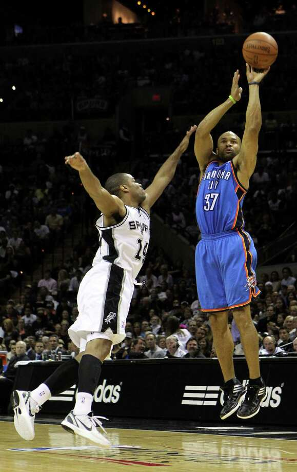 Oklahoma City Thunder's Derek Fisher (37) shoots over San Antonio Spurs' Gary Neal (14) during the first half of game one of the NBA Western Conference Finals in San Antonio, Texas on Sunday, May 27, 2012. Photo: Kin Man Hui, Express-News / © 2012 San Antonio Express-News