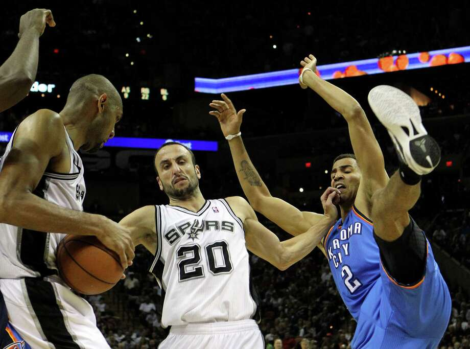 San Antonio Spurs' Tim Duncan (21), San Antonio Spurs' Manu Ginobili (20) and Oklahoma City Thunder's Thabo Sefolosha (2) contest a rebound during the first half of game one of the NBA Western Conference Finals in San Antonio, Texas on Sunday, May 27, 2012. Photo: Kin Man Hui, Express-News / © 2012 San Antonio Express-News