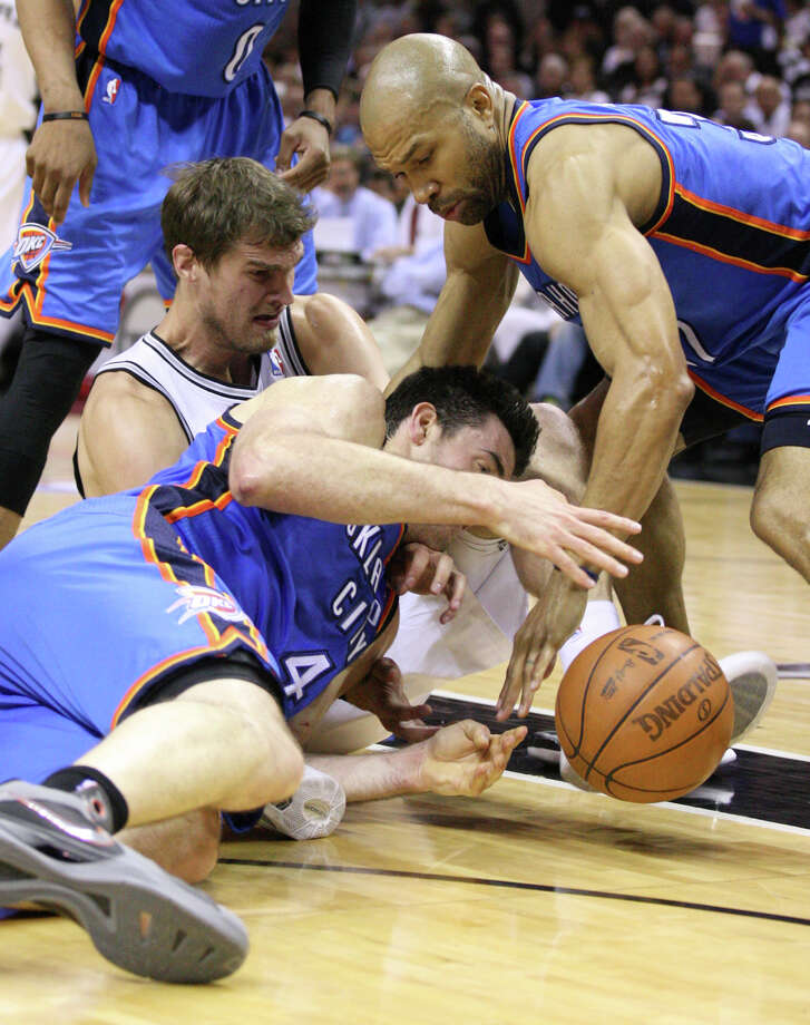 San Antonio Spurs' Tiago Splitter (22) goes for a loose ball against Oklahoma City Thunder's Nick Collison (4) and Oklahoma City Thunder's Derek Fisher (37) during the first half of game one of the NBA Western Conference Finals in San Antonio, Texas, Sunday, May 27, 2012. Photo: Edward A. Ornelas, Express-News / © 2012 San Antonio Express-News