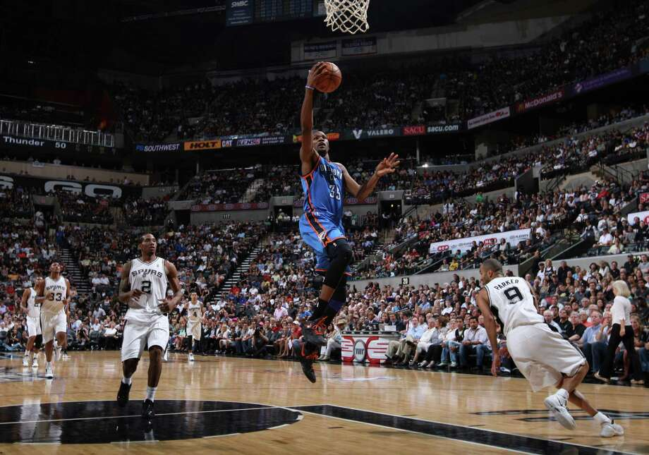 Oklahoma City Thunder's Kevin Durant (35) lays the ball in during the second half of game one of the NBA Western Conference Finals in San Antonio, Texas, Sunday, May 27, 2012. Photo: Edward A. Ornelas, Express-News / © 2012 San Antonio Express-News