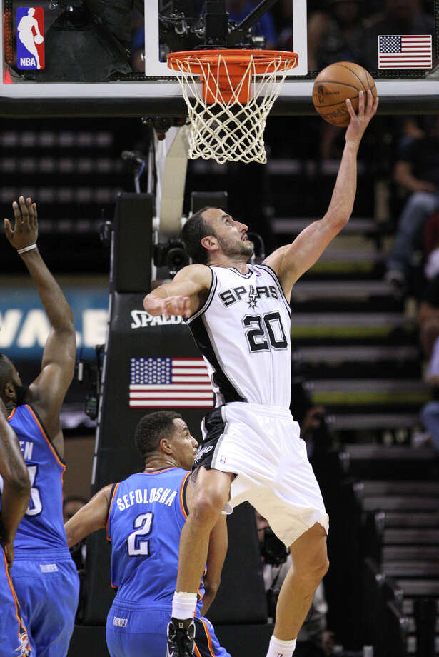 San Antonio Spurs' Manu Ginobili (20) lays the ball in during the second half of game one of the NBA Western Conference Finals in San Antonio, Texas, Sunday, May 27, 2012. Photo: Edward A. Ornelas, Express-News / © 2012 San Antonio Express-News