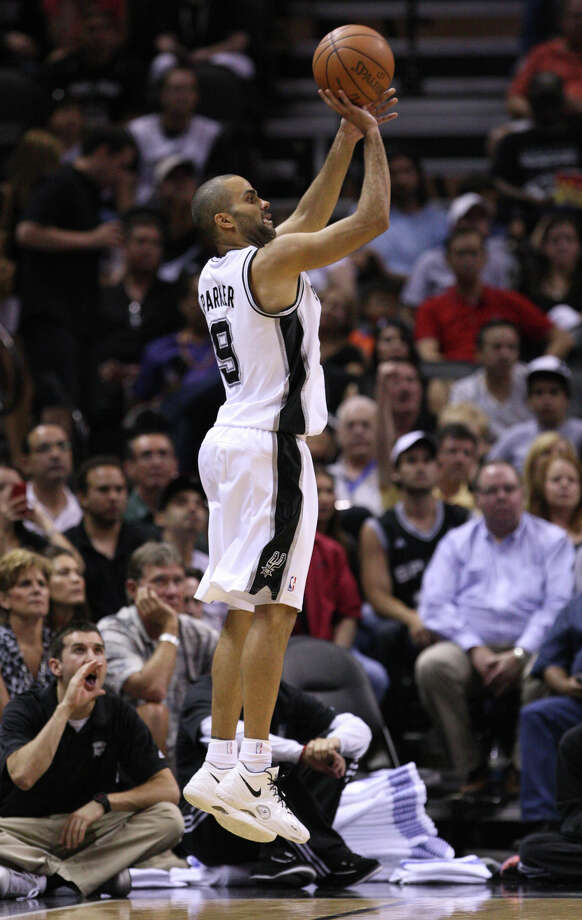 San Antonio Spurs' Tony Parker (9) shoots a three point basket during the second half of game one of the NBA Western Conference Finals in San Antonio, Texas, Sunday, May 27, 2012. Photo: Edward A. Ornelas, Express-News / © 2012 San Antonio Express-News