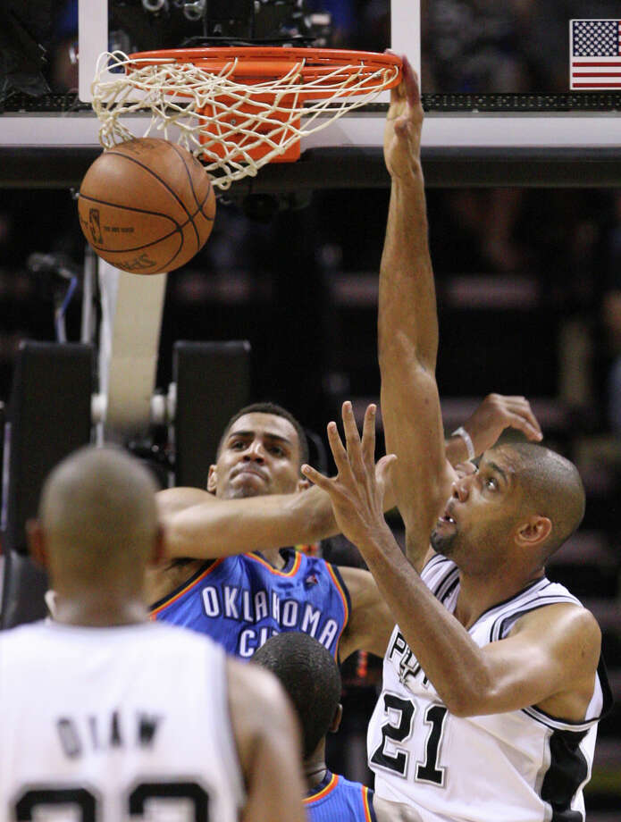 San Antonio Spurs' Tim Duncan (21) dunks on Oklahoma City Thunder's Thabo Sefolosha (2) during the second half of game one of the NBA Western Conference Finals in San Antonio, Texas, Sunday, May 27, 2012. Photo: Edward A. Ornelas, Express-News / © 2012 San Antonio Express-News