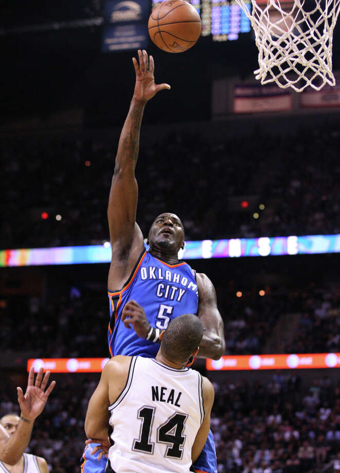 Oklahoma City Thunder's Kendrick Perkins (5) shoots over San Antonio Spurs' Gary Neal (14) during the second half of game one of the NBA Western Conference Finals in San Antonio, Texas, Sunday, May 27, 2012. Photo: Edward A. Ornelas, Express-News / © 2012 San Antonio Express-News