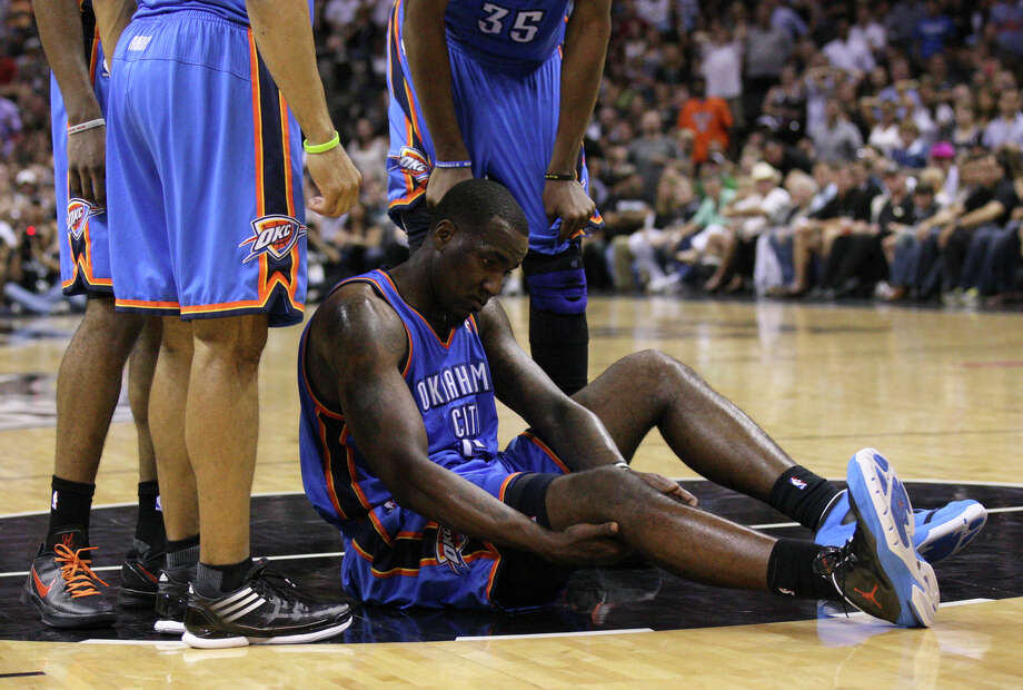 Oklahoma City Thunder's Kendrick Perkins (5) stays on the court after being fouled during the second half of game one of the NBA Western Conference Finals in San Antonio, Texas, Sunday, May 27, 2012. Photo: Edward A. Ornelas, Express-News / © 2012 San Antonio Express-News