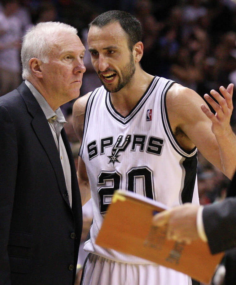 San Antonio Spurs' Manu Ginobili (20) talks to San Antonio Spurs coach Gregg Popovich during the second half of game one of the NBA Western Conference Finals in San Antonio, Texas, Sunday, May 27, 2012. Photo: Edward A. Ornelas, Express-News / © 2012 San Antonio Express-News