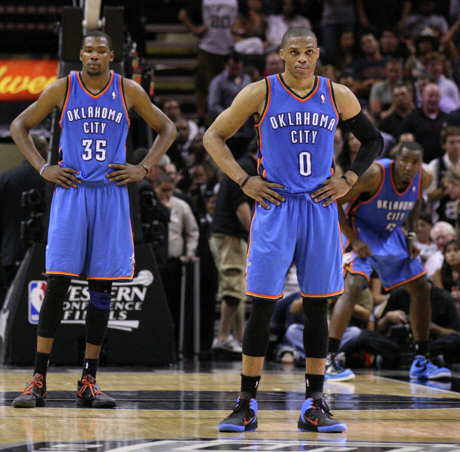 Oklahoma City Thunder's Kevin Durant (35) and Oklahoma City Thunder's Russell Westbrook (0) look on during the second half of game one of the NBA Western Conference Finals in San Antonio, Texas, Sunday, May 27, 2012. Photo: Edward A. Ornelas, Express-News / © 2012 San Antonio Express-News