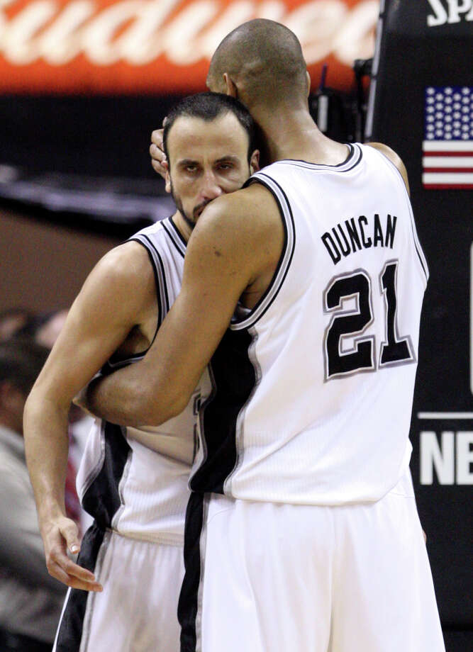 San Antonio Spurs' Tim Duncan (21) embraces San Antonio Spurs' Manu Ginobili (20) during the second half of game one of the NBA Western Conference Finals in San Antonio, Texas, Sunday, May 27, 2012. Photo: Edward A. Ornelas, Express-News / © 2012 San Antonio Express-News