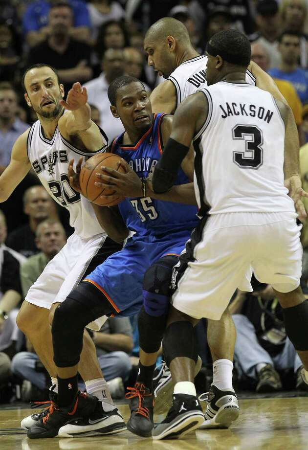 Oklahoma City Thunder's Kevin Durant (35) is pressured by San Antonio Spurs' Manu Ginobili (20), San Antonio Spurs' Tim Duncan (21) and San Antonio Spurs' Stephen Jackson (3) during the second half of game one of the NBA Western Conference Finals in San Antonio, Texas on Sunday, May 27, 2012. Photo: Kin Man Hui, Express-News / © 2012 San Antonio Express-News