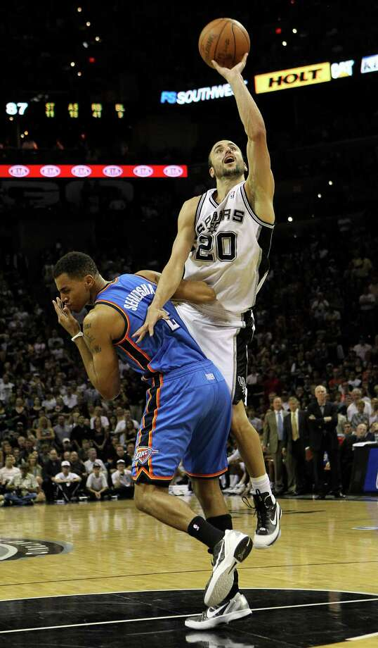 San Antonio Spurs' Manu Ginobili (20) shoots over Oklahoma City Thunder's Thabo Sefolosha (2) during the second half of game one of the NBA Western Conference Finals in San Antonio, Texas on Sunday, May 27, 2012. Photo: Kin Man Hui, Express-News / © 2012 San Antonio Express-News