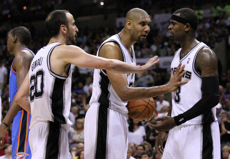San Antonio Spurs' Manu Ginobili (20) and San Antonio Spurs' Tim Duncan (21) talk to San Antonio Spurs' Stephen Jackson (3) after Jackson fouled Kevin Durant (35) during the second half of game one of the NBA Western Conference Finals in San Antonio, Texas, Sunday, May 27, 2012. Photo: Edward A. Ornelas, Express-News / © 2012 San Antonio Express-News