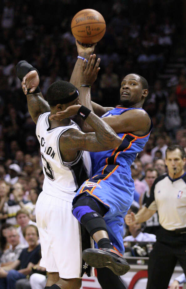 Oklahoma City Thunder's Kevin Durant (35) passes against San Antonio Spurs' Stephen Jackson (3) during the second half of game one of the NBA Western Conference Finals in San Antonio, Texas, Sunday, May 27, 2012.  Jackson was called for the foul on the play. Photo: Edward A. Ornelas, Express-News / © 2012 San Antonio Express-News