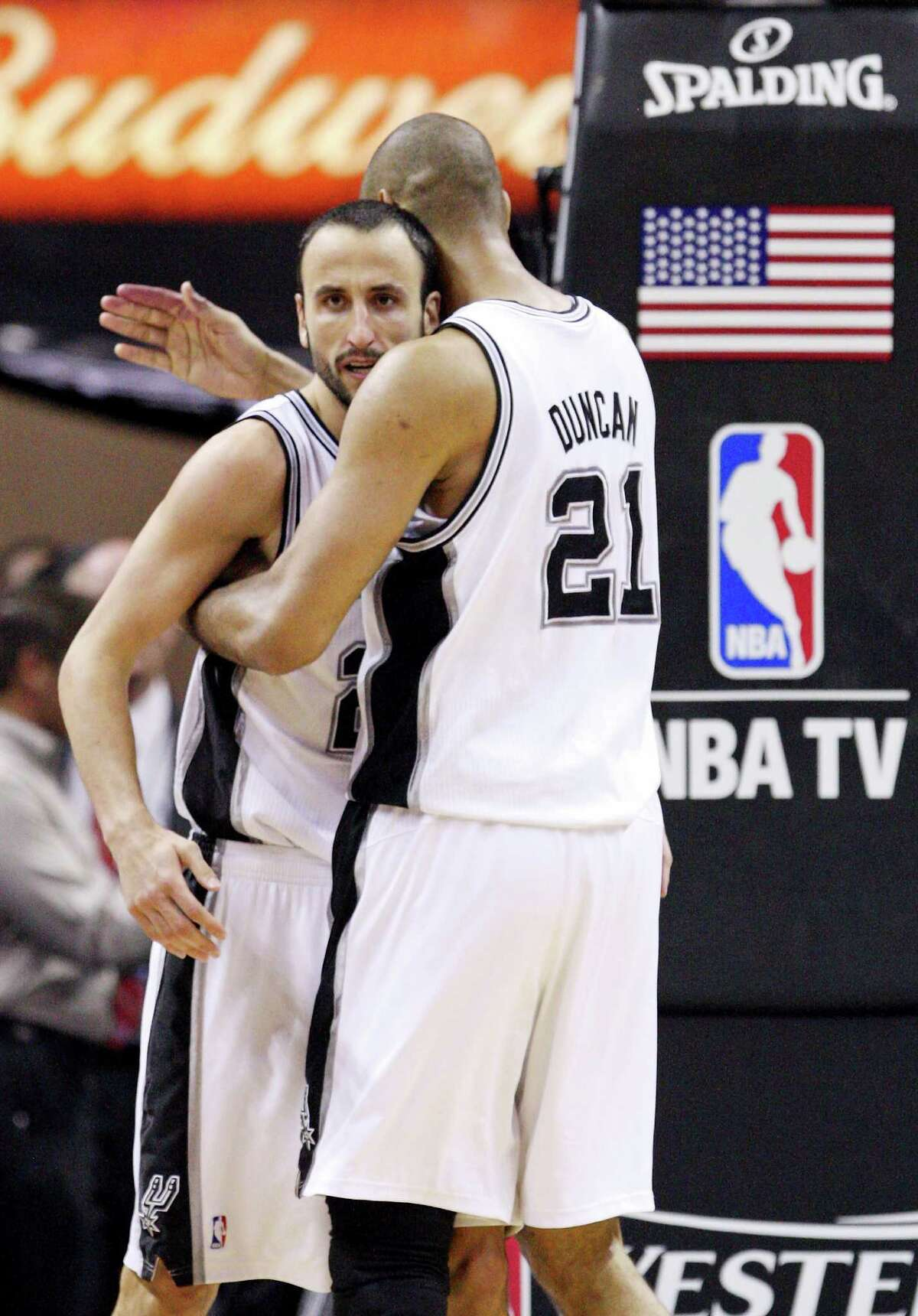 San Antonio Spurs' Tim Duncan (21) embraces San Antonio Spurs' Manu Ginobili (20) during the second half of game one of the NBA Western Conference Finals in San Antonio, Texas, Sunday, May 27, 2012.