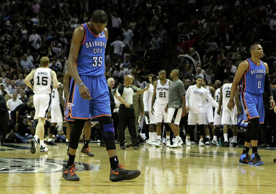 Oklahoma City Thunder's Kevin Durant (35) walks off the court during the second half of game one of the NBA Western Conference Finals in San Antonio, Texas on Sunday, May 27, 2012.  The Spurs won 101-98. Photo: Kin Man Hui, Express-News / © 2012 San Antonio Express-News
