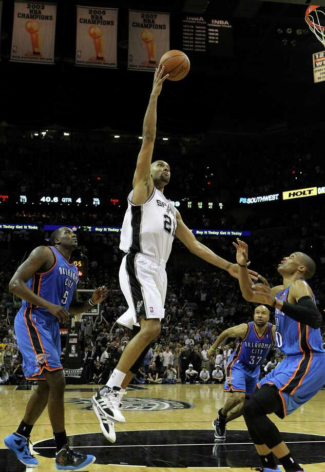 San Antonio Spurs' Manu Ginobili (20) shoots over Oklahoma City Thunder's Russell Westbrook (0) and Oklahoma City Thunder's Kendrick Perkins (5) during the second half of game one of the NBA Western Conference Finals in San Antonio, Texas on Sunday, May 27, 2012.  The Spurs won 101-98. Photo: Kin Man Hui, Express-News / © 2012 San Antonio Express-News