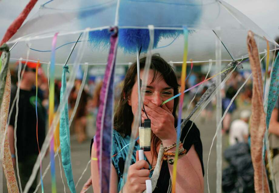 A concert attendee shows off her decorated umbrella. Photo: SOFIA JARAMILLO / SEATTLEPI.COM