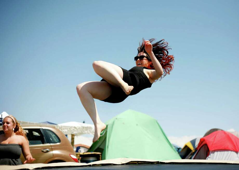 A concert attendee  jumps on a trampoline in the campground. Photo: SOFIA JARAMILLO / SEATTLEPI.COM