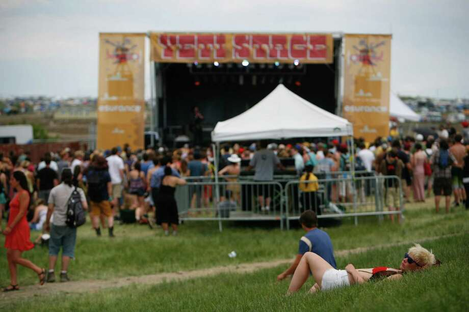 A concert attendee rests in front of the Yeti Stage. Photo: SOFIA JARAMILLO / SEATTLEPI.COM